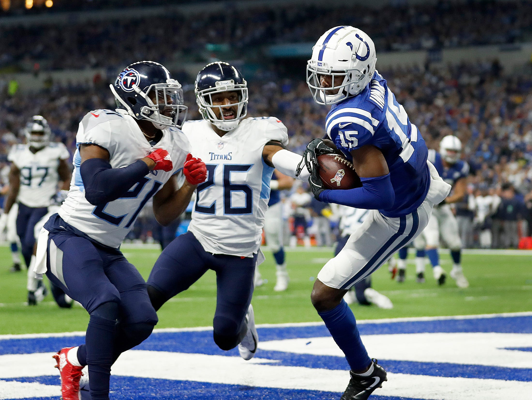 Indianapolis Colts wide receiver Dontrelle Inman (15) makes a touchdown catch behind Tennessee Titans cornerback Malcolm Butler (21) in the second half of the game at Lucas Oil Stadium on Sunday, Nov. 18, 2018. The Colts defeated the Titans 38-10.