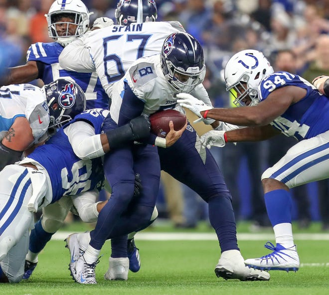 Indianapolis Colts defensive tackle Denico Autry (96) sacks Tennessee Titans quarterback Marcus Mariota (8) at Lucas Oil Stadium in Indianapolis, on Sunday, Nov. 18, 2018. Moriota would leave the field after the sack.