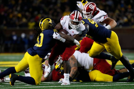 Indiana running back Stevie Scott (21) tries to break the tackle of Michigan linebacker Devin Bush (10) in the second half of an NCAA college football game in Ann Arbor, Mich., Saturday, Nov. 17, 2018.