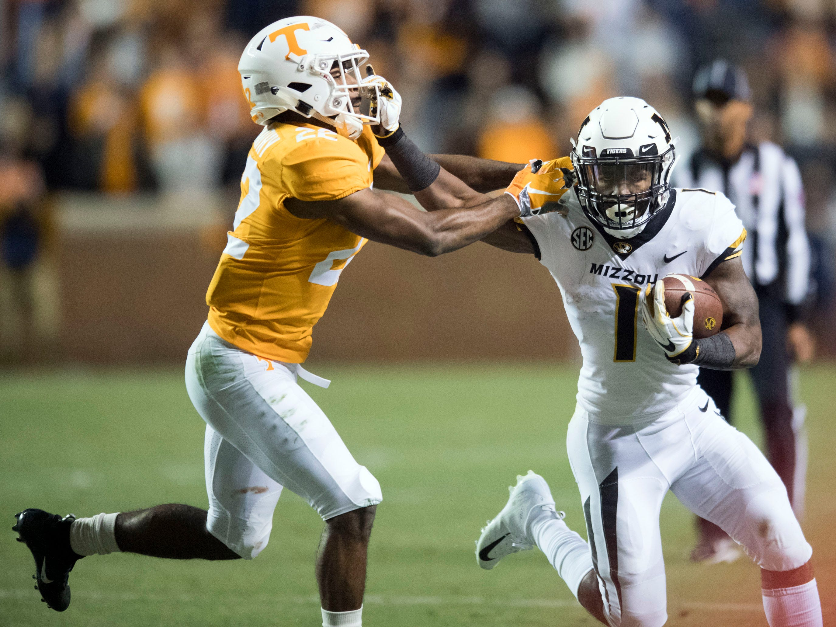 Missouri running back Tyler Badie (1) holds back Tennessee defensive back Micah Abernathy (22) during the game on Saturday, November 17, 2018.