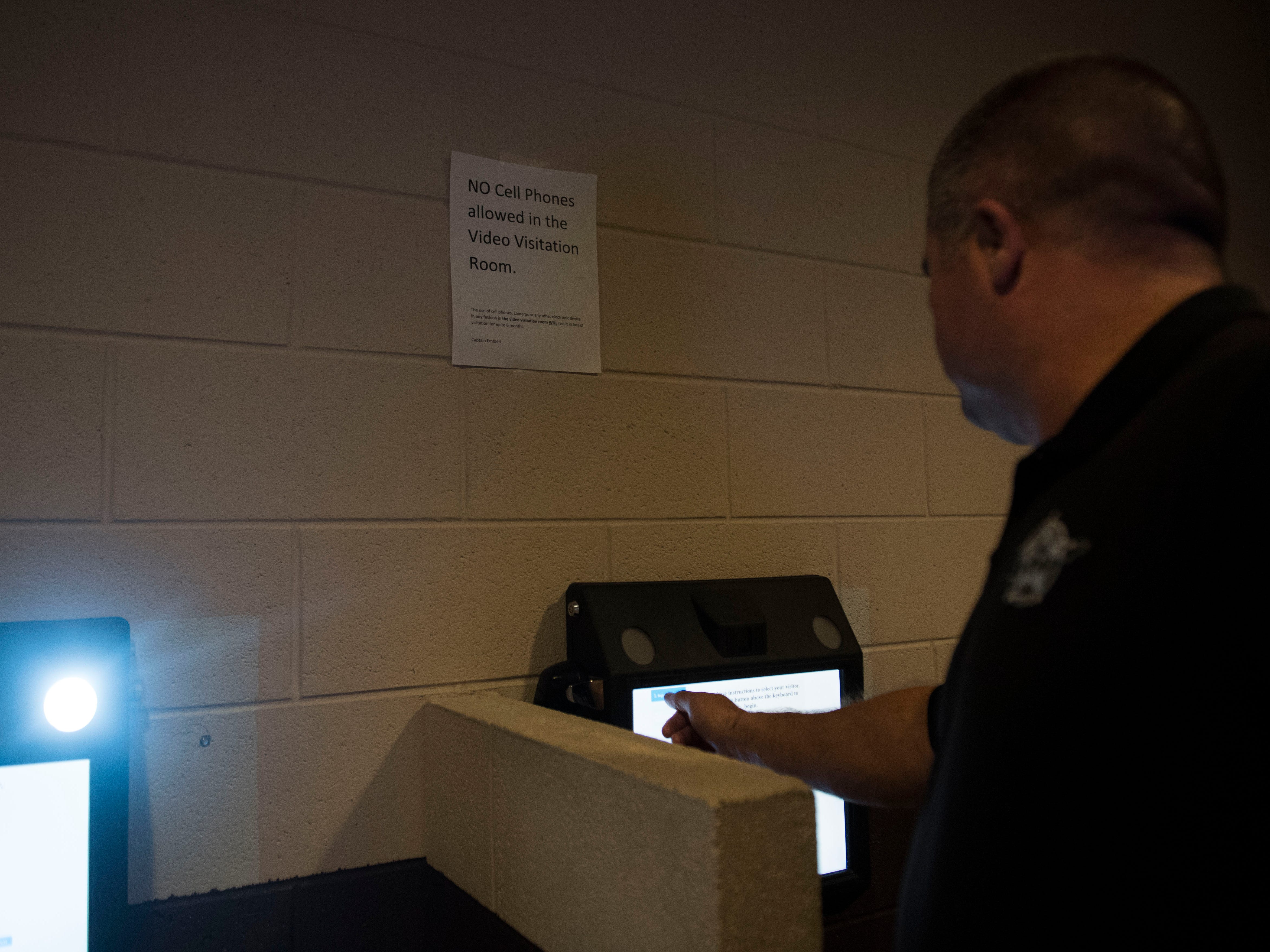 Tim Phillips, Chief Deputy at the Roane County Sheriff's Office demonstrates how to use the video visitation system in the Roane County Sheriff's Office and Detention Center Wednesday, May 30, 2018.