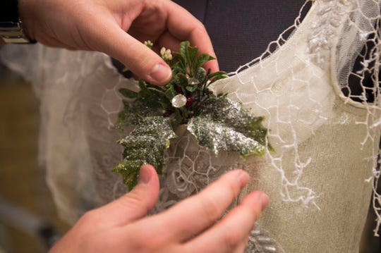 "Kyle Schellinger, a draper, works on a costume for the Ghost of Christmas Past for Clarence Brown Theatre's annual production of ""A Christmas Carol,"" at the University of Tennessee on Tuesday, Nov. 11, 2018."