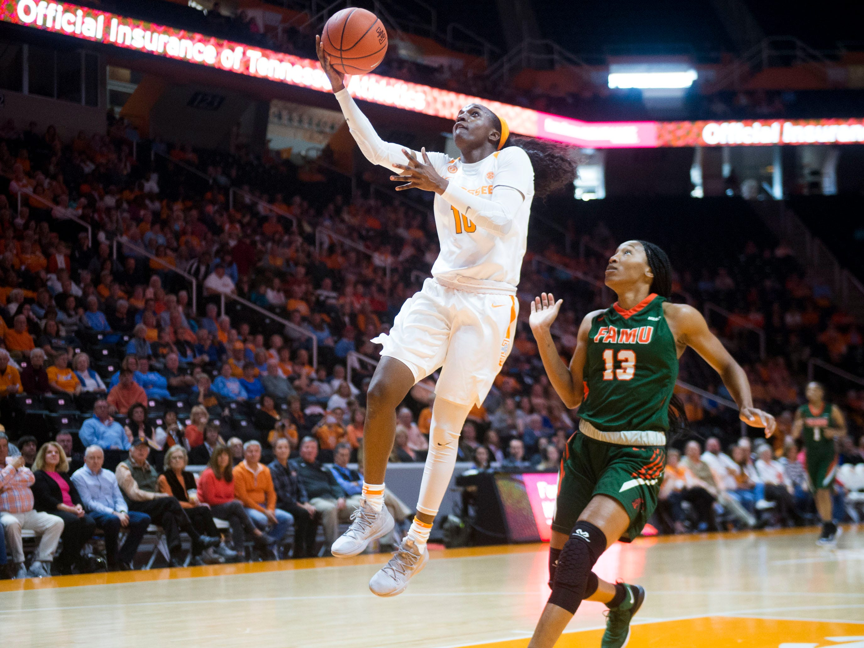 Tennessee's Meme Jackson (10) attempts to score while defended by Florida A&M's Dy'Manee Royal (13) on Sunday, November 18, 2018 at Thompson-Boling Arena.