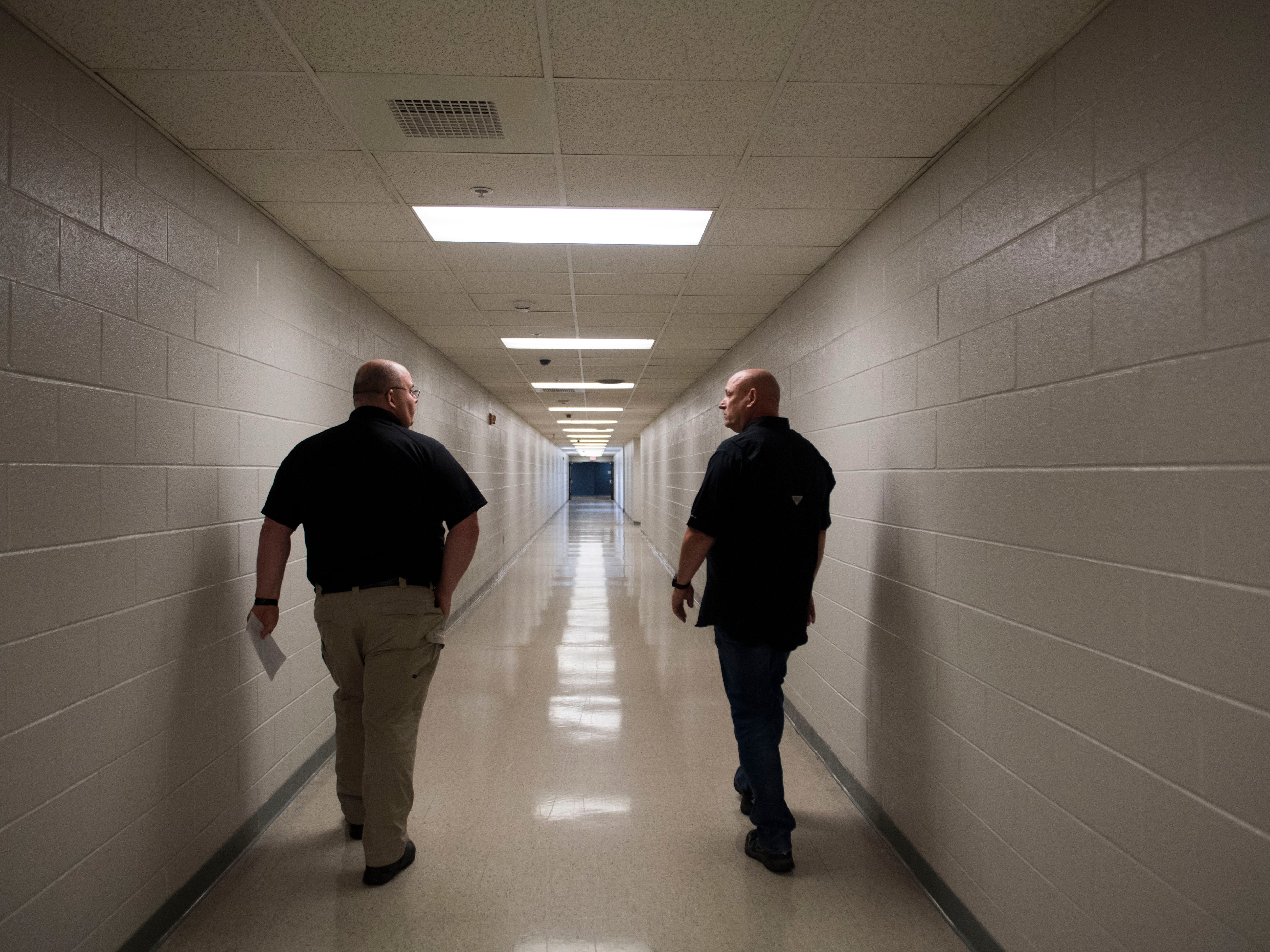 At left Capitan Terry Wilshire and Director of Corrections for the Knox County Sheriff's Office Rodney Bivens, walk down a hallway at the Knox County Jail in Knox County Tuesday, May 15, 2018.at the Knox County Jail in Knox County Tuesday, May 15, 2018.