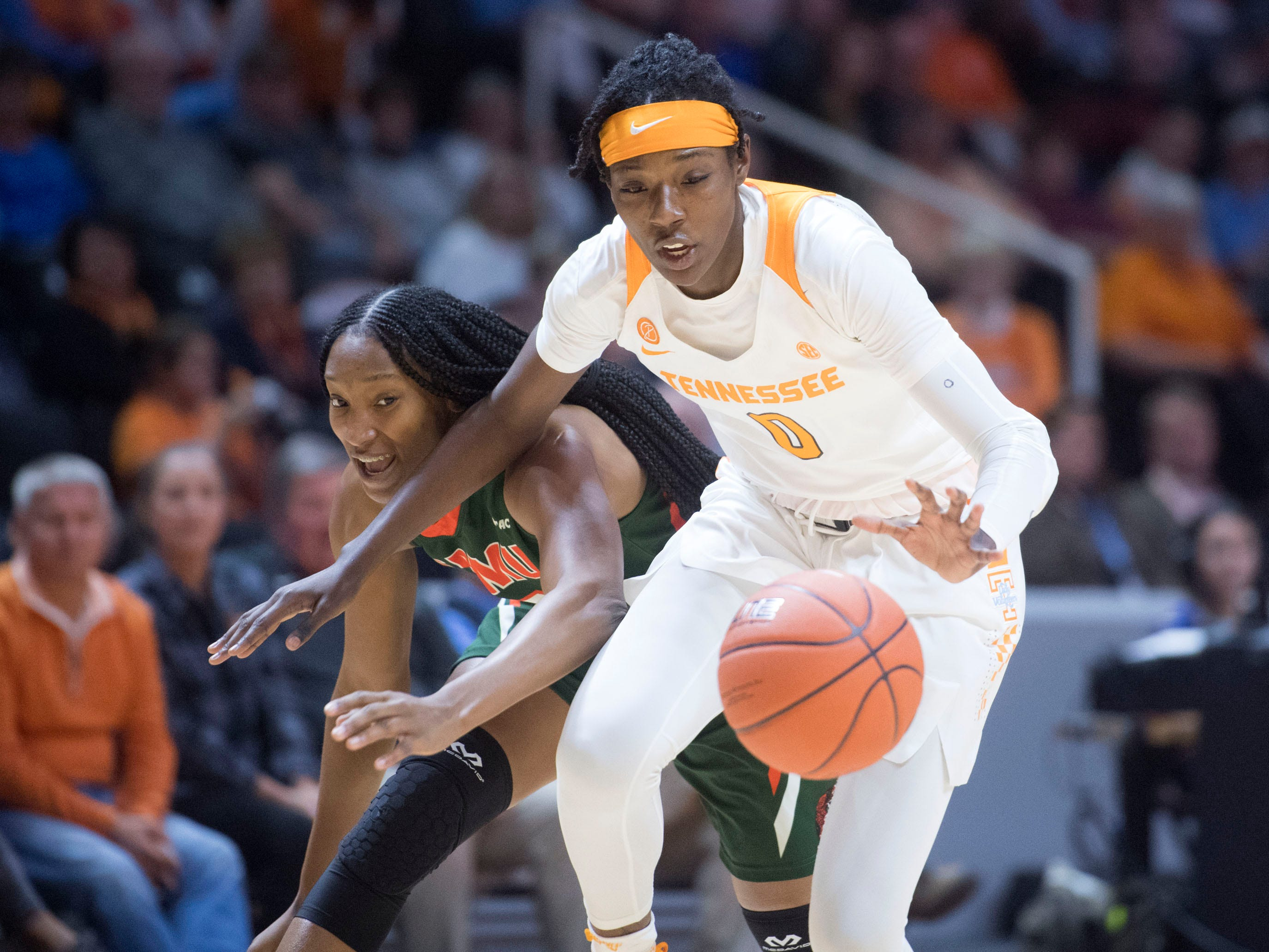 /Tennessee's Rennia Davis (0) protects the ball from Florida A&M's Dy'Manee Royal (13) on Sunday, November 18, 2018 at Thompson-Boling Arena.