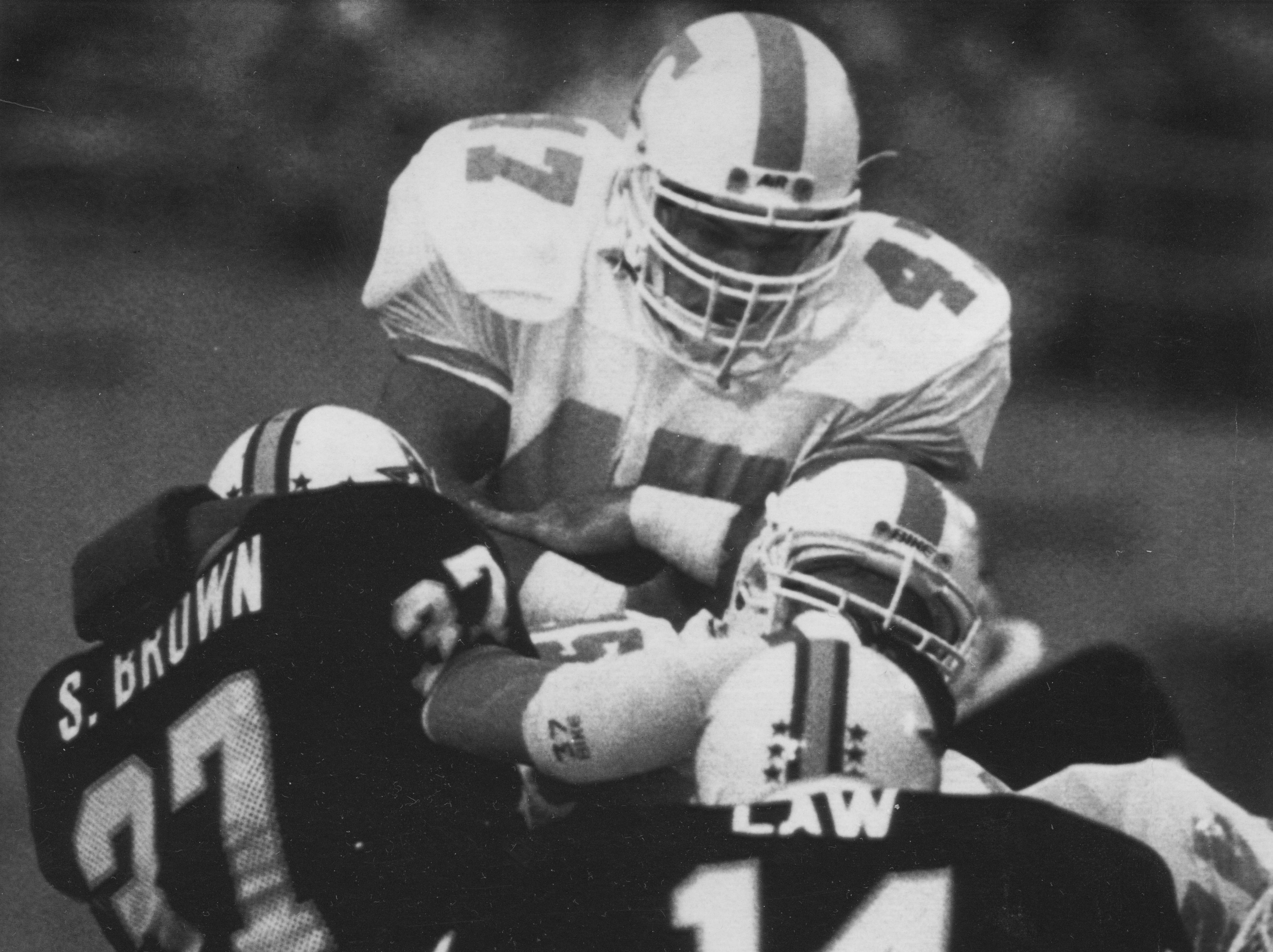 Greg Master dives over the top for a first down in 1988.