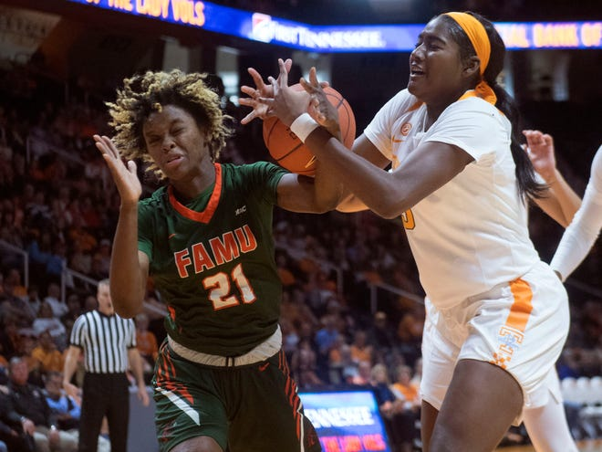 Tennessee's Kamera Harris (5) and Florida A&M's Keziah Dilworth (21) fight for a rebound on Sunday.