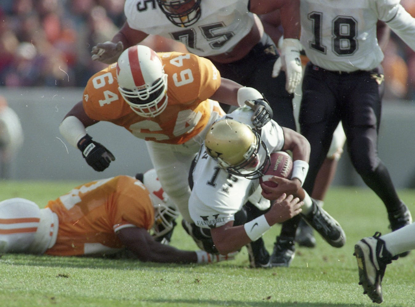 Vanderbilt's quarterback Damian Allen gets sacked by Tennessee's Steve White on November 25, 1995.