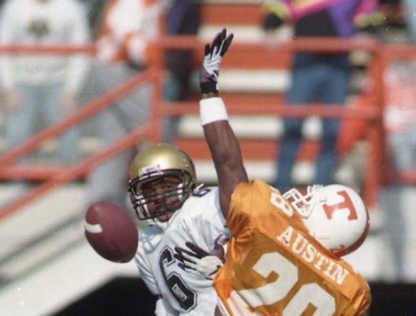 Vanderbilt's Kenny Simon (6) and Tennessee's Raymond Austin during game action on November 25, 1995.