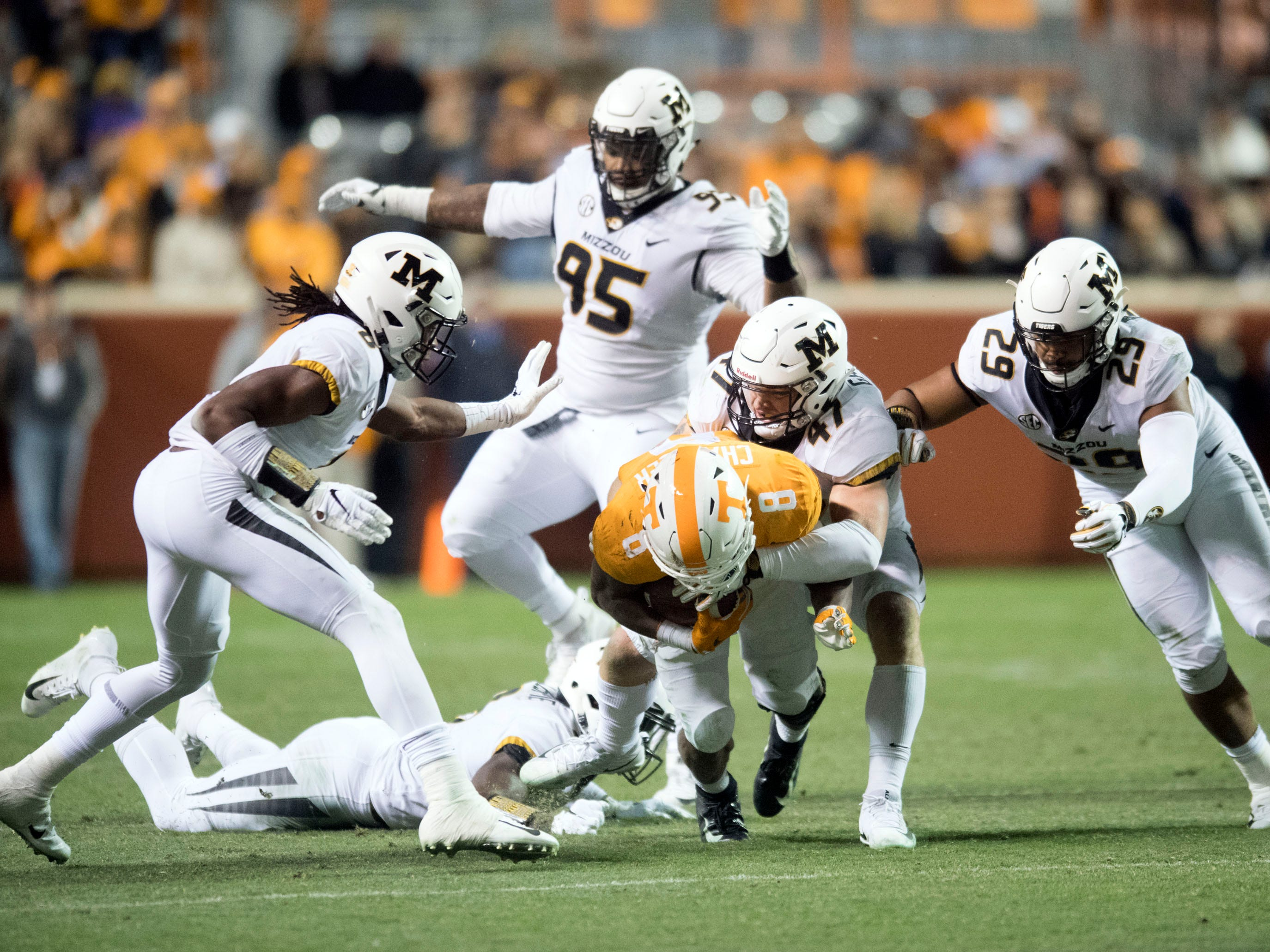 Tennessee running back Ty Chandler (8) struggles against the Missouri defense on Saturday, November 17, 2018.