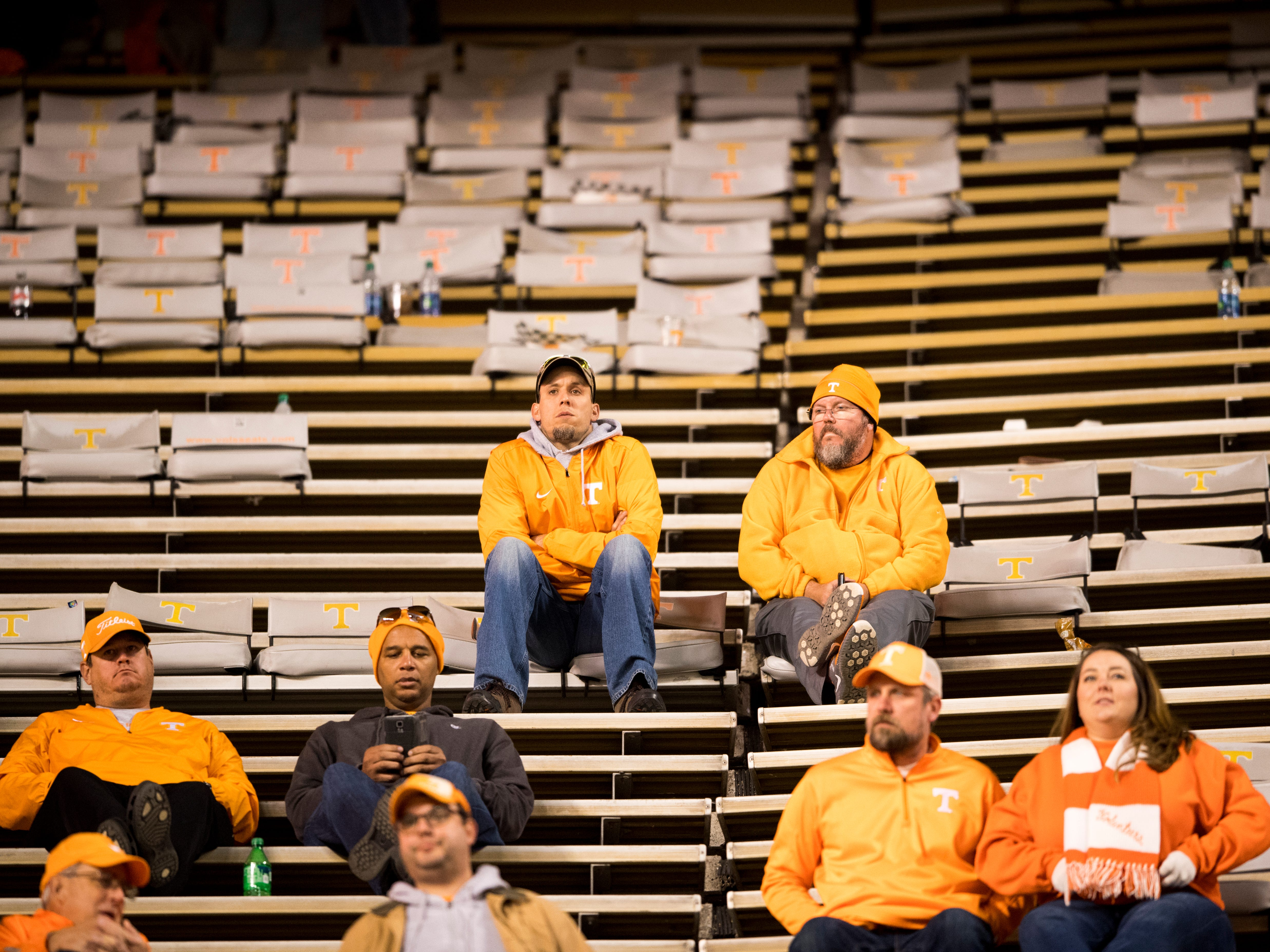 Fans watch from empty stands during the Tennessee Volunteers game against the Missouri Tigers in Neyland Stadium on Saturday, November 17, 2018.