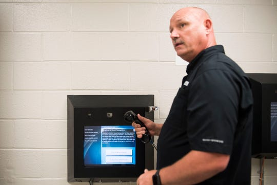 Rodney Bivens, director of corrections for the Knox County Sheriff's Office, demonstrates how to operate a video visitation terminal at the Knox County jail May 15.