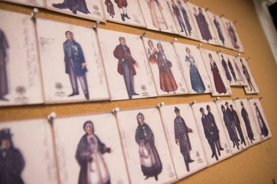 "Costume sketches hang above surgers as finishing touches are put on costumes for Clarence Brown Theatre's annual production of ""A Christmas Carol,"" at the University of Tennessee on Tuesday, Nov. 11, 2018."