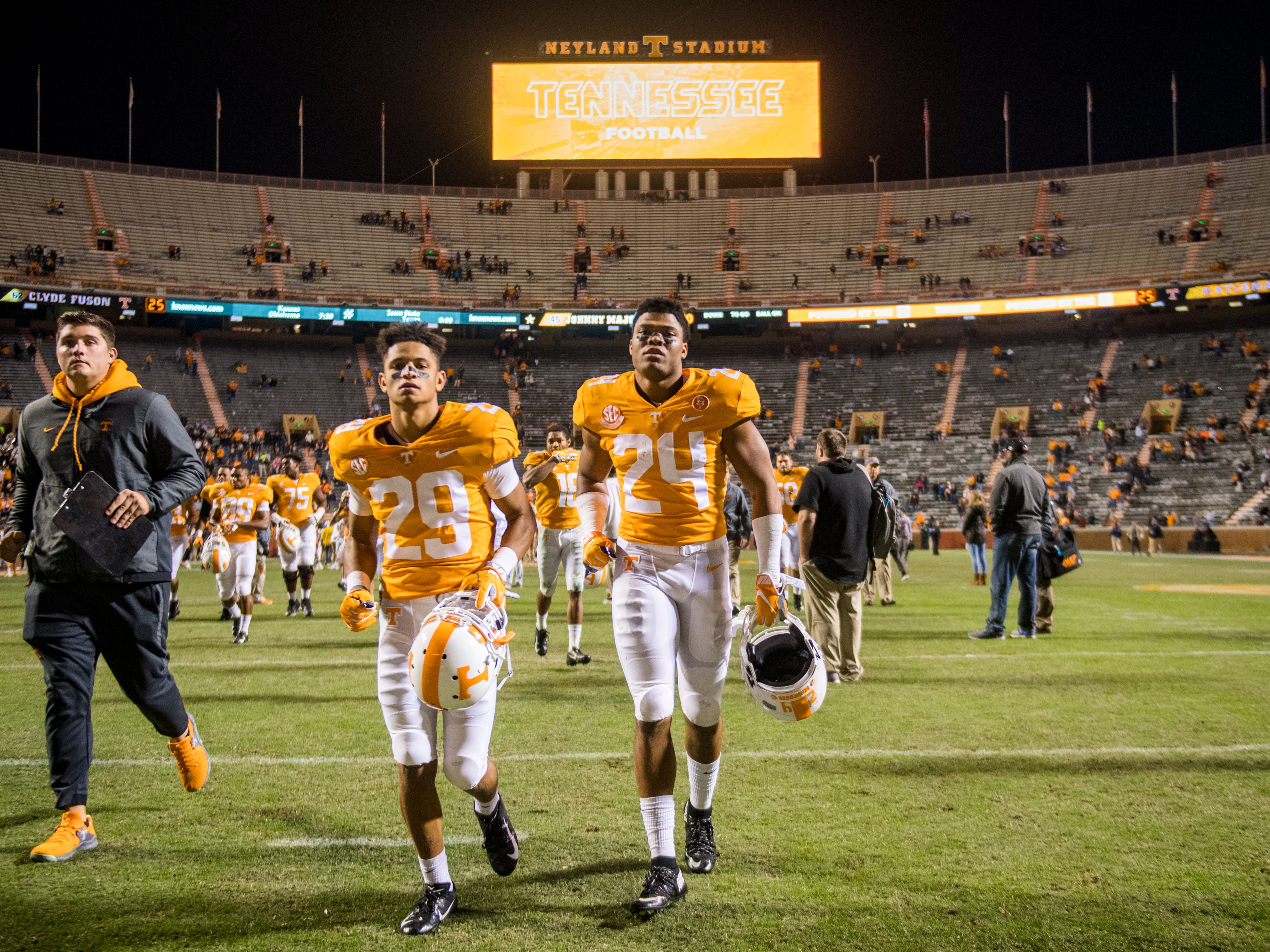 Tennessee defensive back Todd Kelly Jr. (24) and Tennessee defensive back Brandon Davis (29) run off the field after the Tennessee Volunteers game against the Missouri Tigers in Neyland Stadium on Saturday, November 17, 2018.