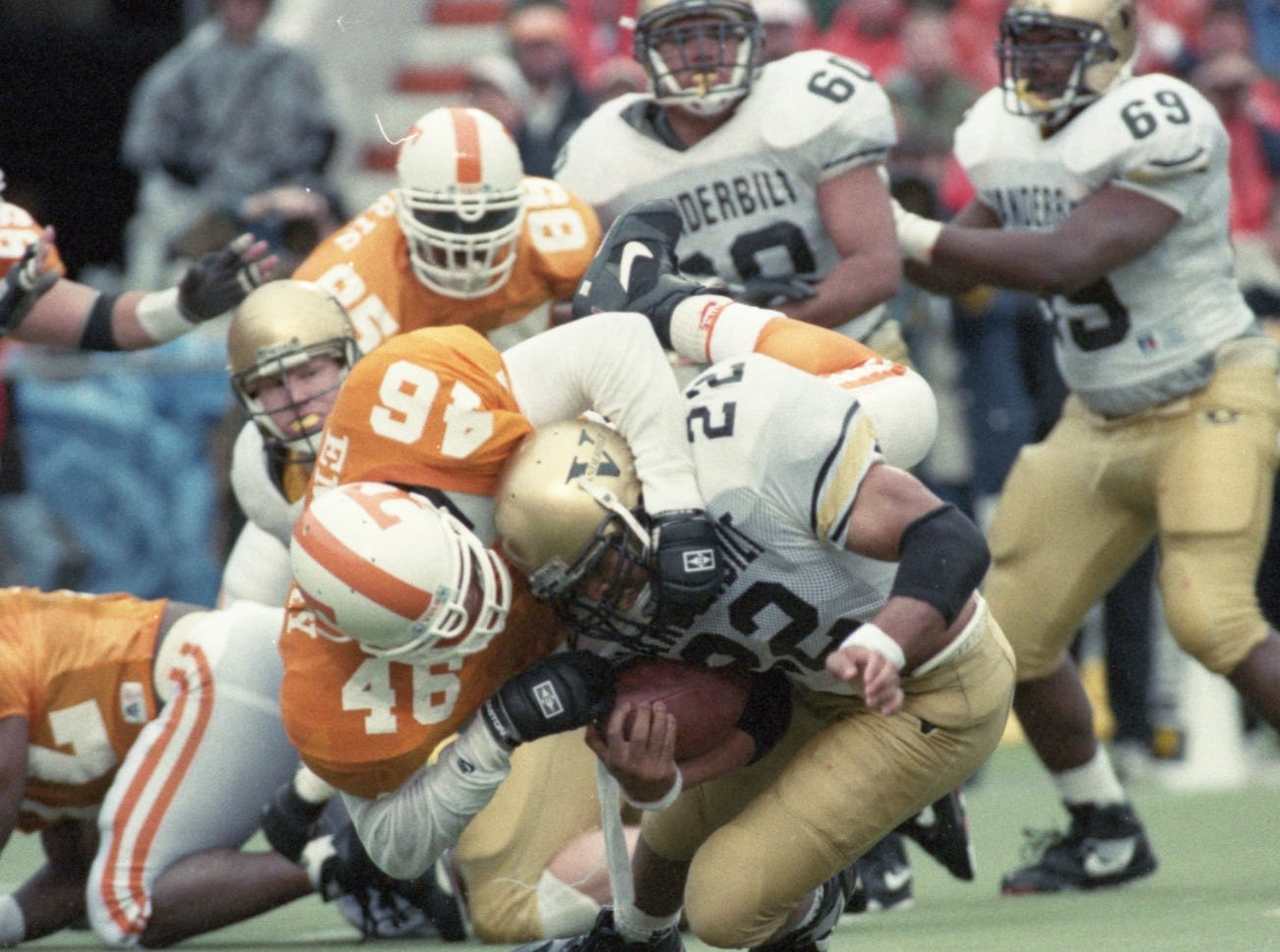 Tennessee's John Emery (46) takes down Vanderbilt's Eric Lewis (22) on November 27, 1993.