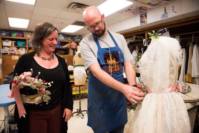 """Kyle Schellinger, consults Melissa Caldwell-Weddig, costume shop manager, while working on a costume for the Ghost of Christmas Past for Clarence Brown Theatre's annual production of """"A Christmas Carol,"""" at the University of Tennessee on Tuesday, Nov. 11, 2018."""