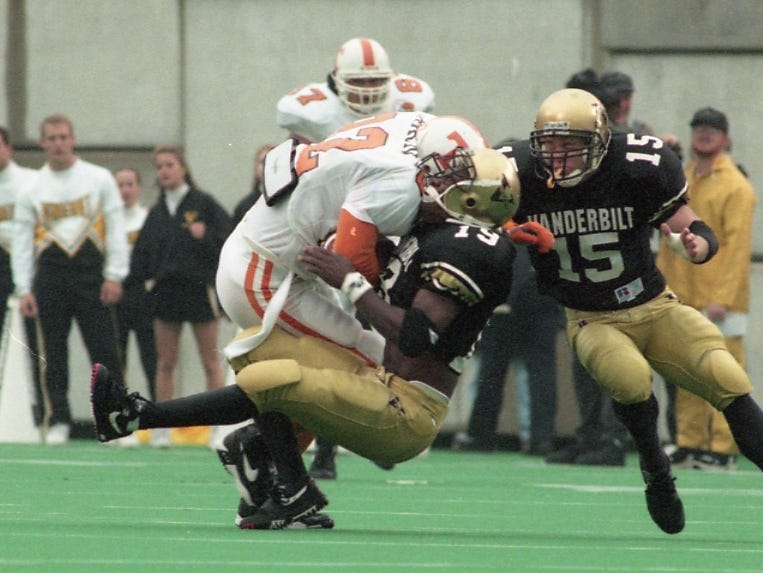 Tennessee's David Horn, left, makes a hard hit on Vanderbilt's Eric Vance on November 26, 1994.