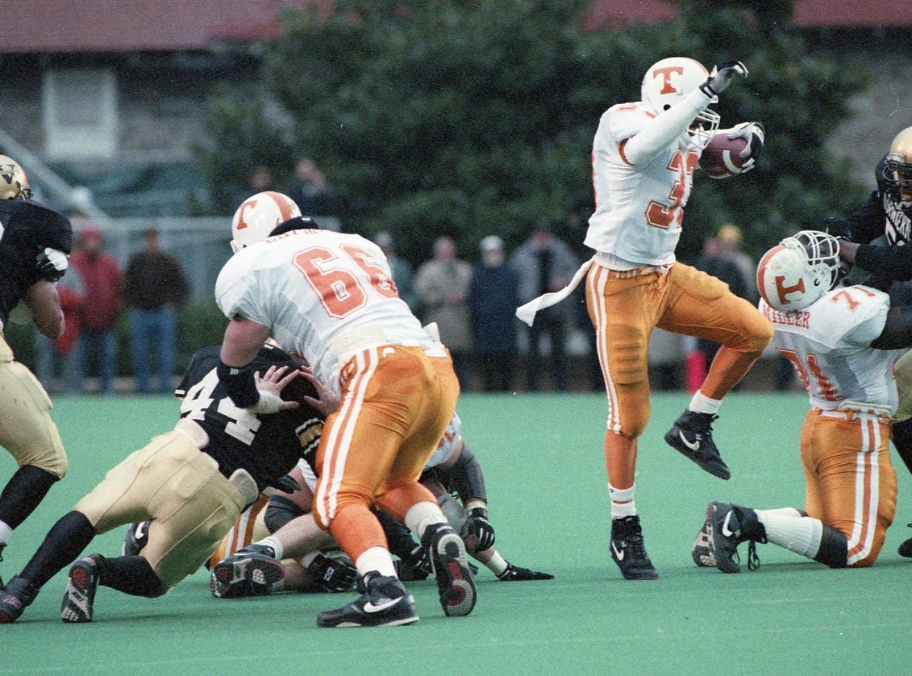 James Stewart stays on his toes as he weaves through the Vanderbilt defense on November 28, 1992.