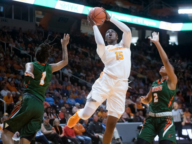Tennessee's Cheridene Green (15) gets a shot at the basket while defended by Florida A&M's Mya Moye (1) and Autumn Goram (2) on Sunday, November 18, 2018 at Thompson-Boling Arena.