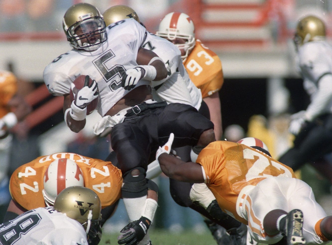 Jessee Sanders (22), George Kidd (42), Scott Galyon (93) shut down Vanderbilt's Jermaine Johnson on November 25, 1995.