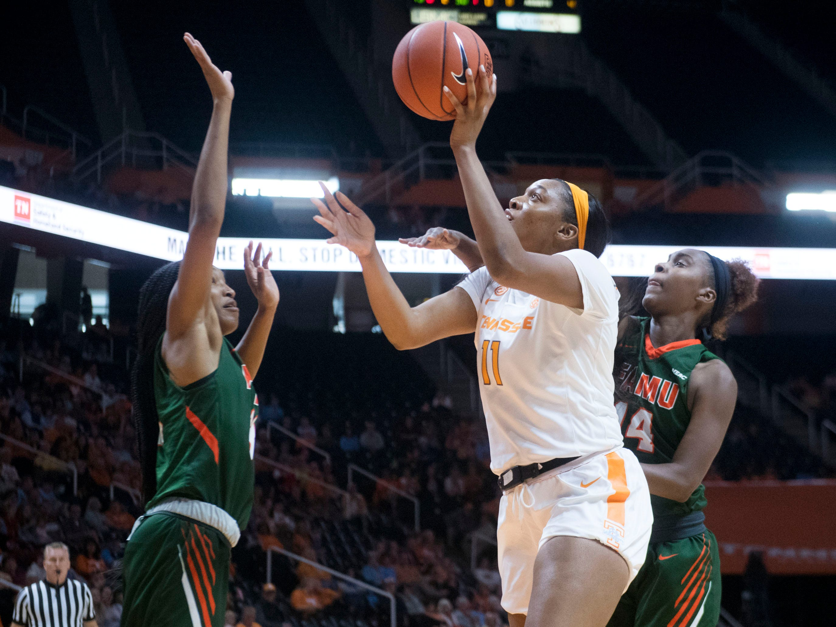 Tennessee's Kasiyahna Kushkituah (11) attempts to score while defended by Florida A&M's Dy'Manee Royal (13) and Tyra James (14) on Sunday, November 18, 2018 at Thompson-Boling Arena.
