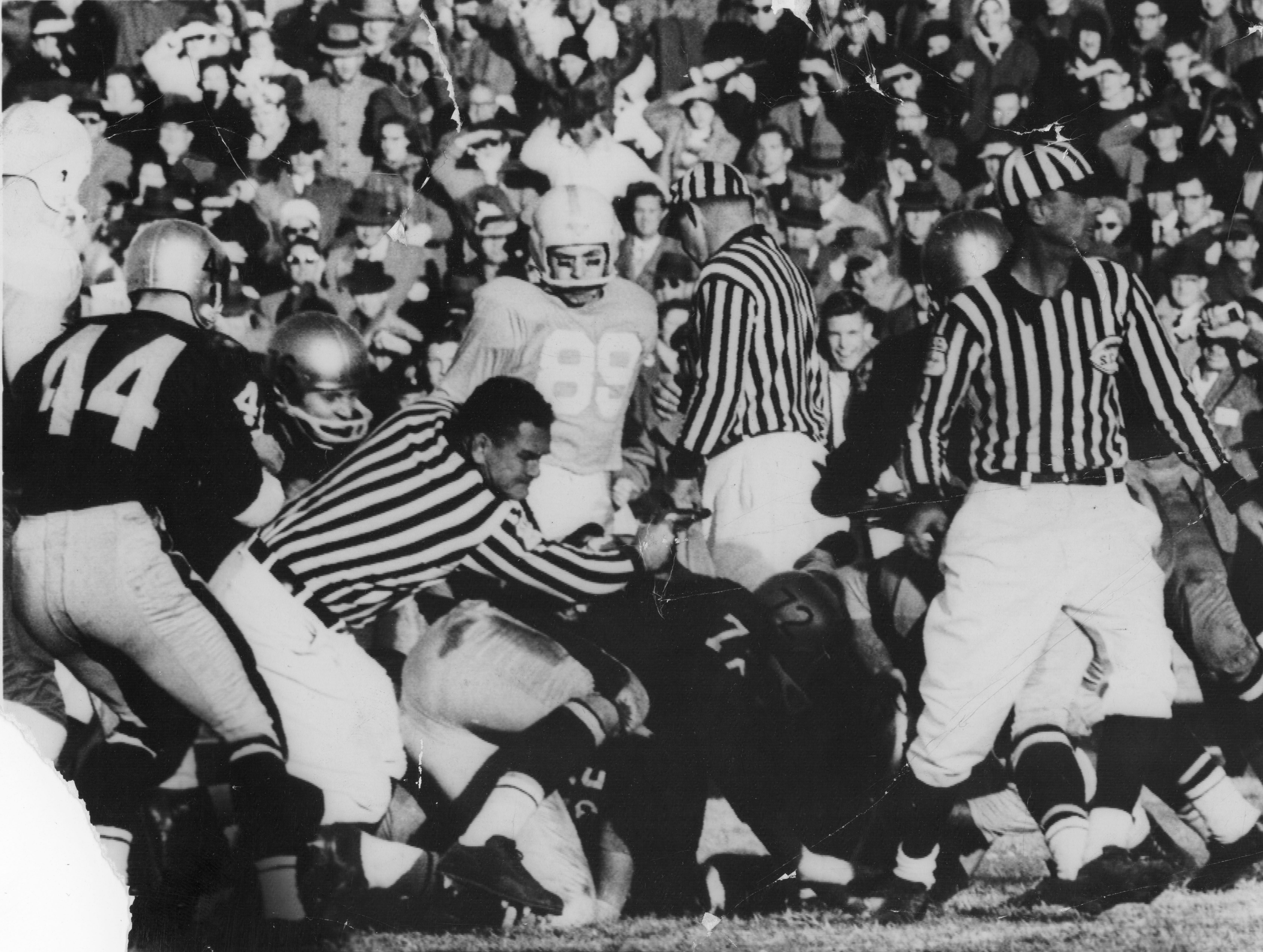 Tom Redmond (72), Ross Morris (44) and Don Deck (89) during action against Vanderbilt on November 30, 1958.