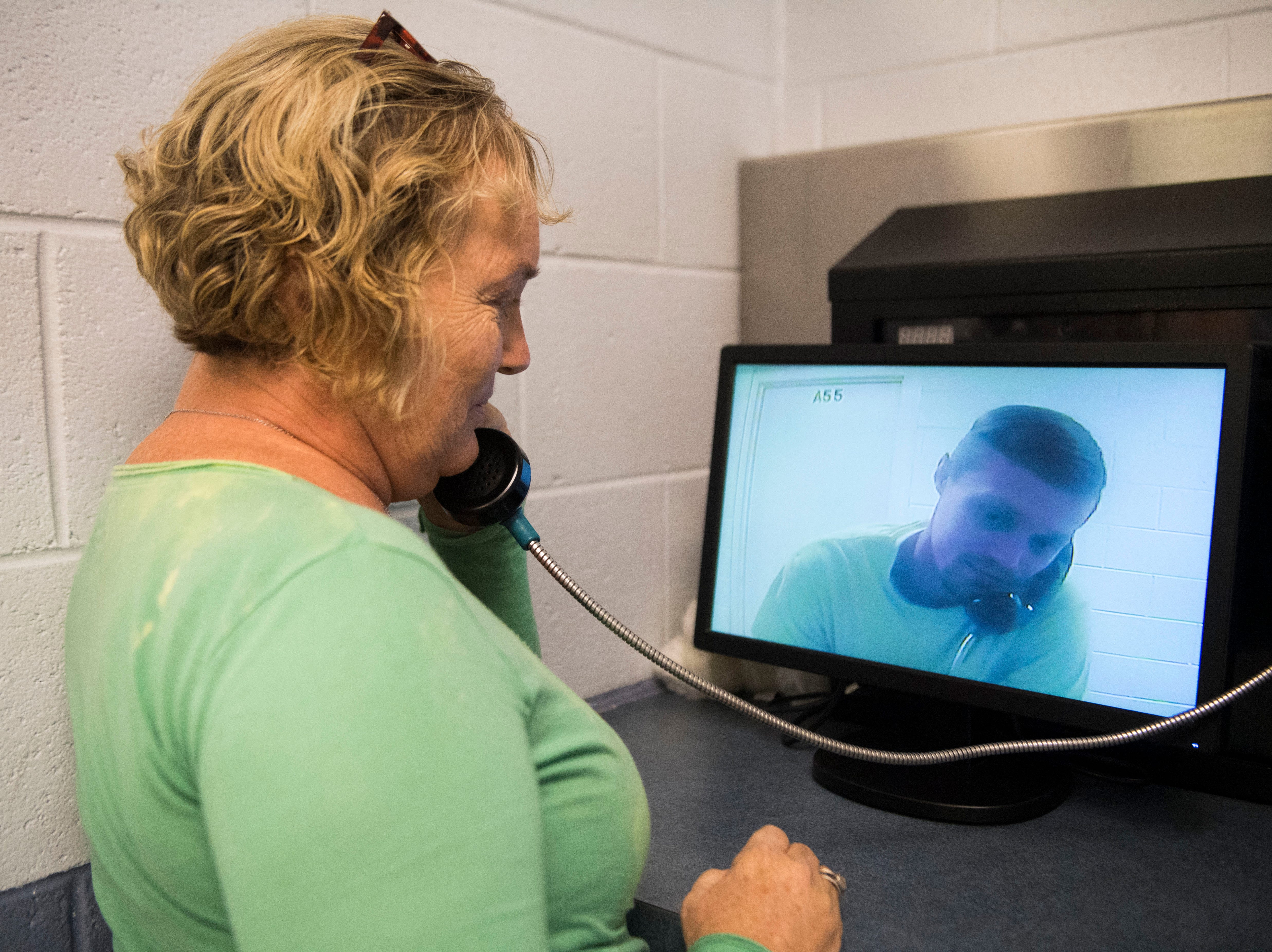 Alice Taylor speaks to her son inmate Wayne Long during a video visitation at Claiborne County Jail in Claiborne County, Wednesday, Oct. 24, 2018.