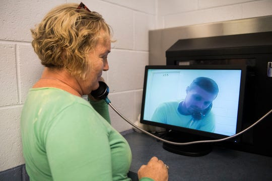 Alice Taylor speaks to her son, inmate Wayne Long, in October 2018 during a video visitation at Claiborne County Jail in Claiborne County, Tennessee.
