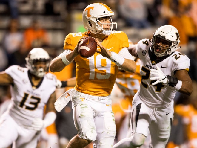 Tennessee quarterback Keller Chryst (19) runs from Missouri defenders during the Tennessee Volunteers game against the Missouri Tigers in Neyland Stadium on Saturday, November 17, 2018.