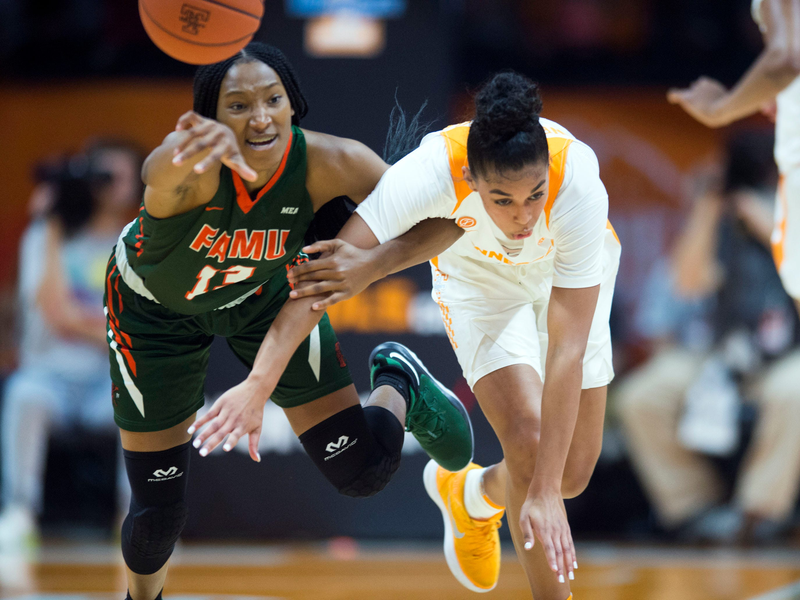 Florida A&M's Dy'Manee Royal (13) is fouled by Tennessee's Evina Westbrook (2) as they chase the ball during their game on Sunday, November 18, 2018 at Thompson-Boling Arena.