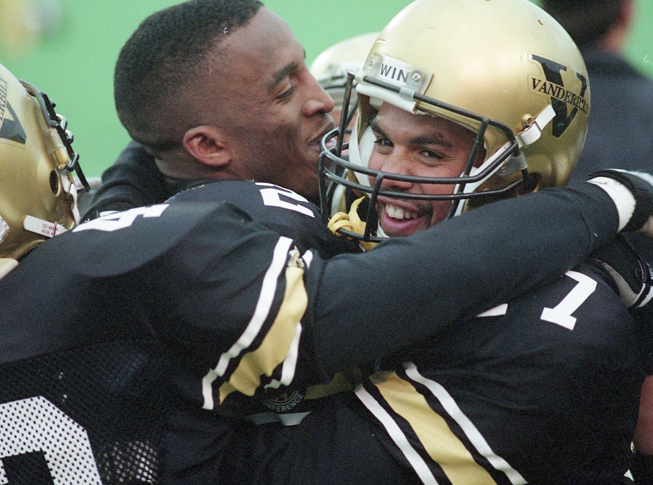 Clarence Sullivan gets a hug after one of three touchdown catches on November 28, 1992. He had six receptions for 222 yards.