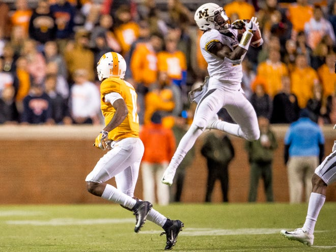 Tennessee wide receiver Jordan Murphy (11) watches as Missouri defensive back DeMarkus Acy (2) intercepts a pass intended for Murphy during the Tennessee Volunteers game against the Missouri Tigers in Neyland Stadium on Saturday, November 17, 2018.
