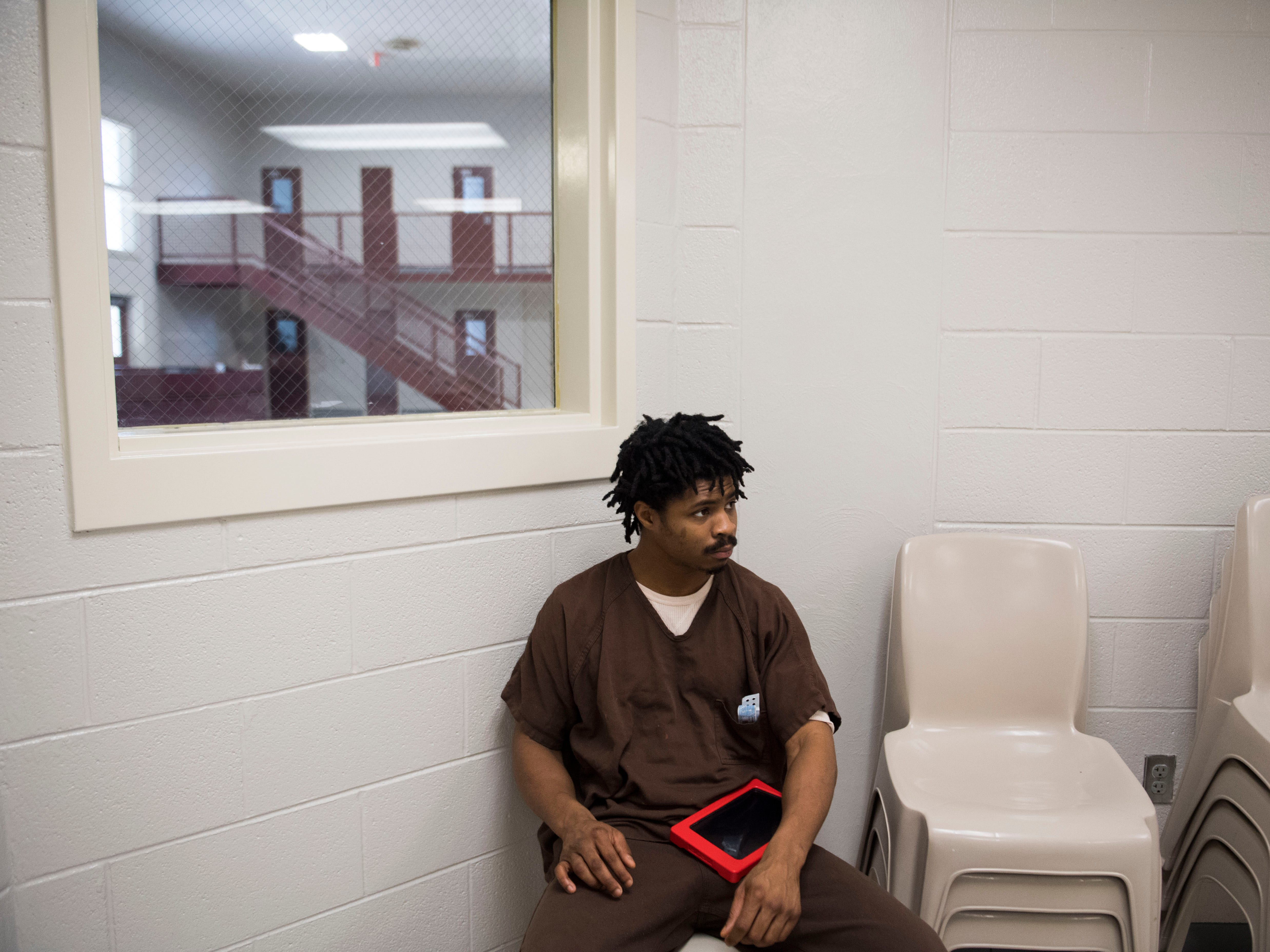 Inmate Kristopher Johnson uses a tablet at the Knox County Jail in Knox County Tuesday, May 15, 2018.