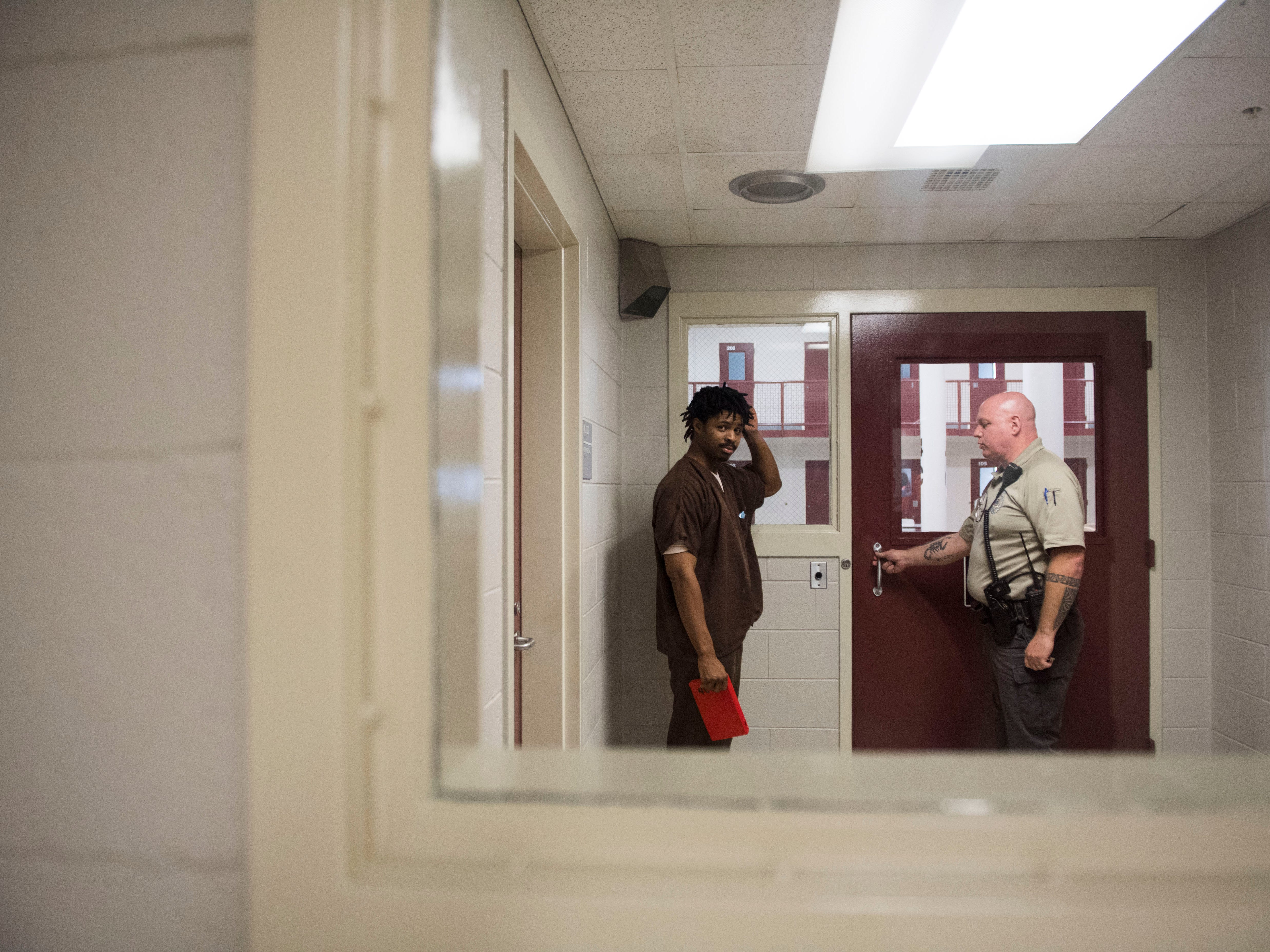 Inmate Kristopher Johnson is escorted back to his cell at the Knox County Jail in Knox County Tuesday, May 15, 2018.