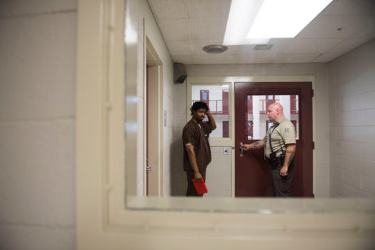 Inmate Kristopher Johnson heads back to his cell at the Knox County jail May 15.