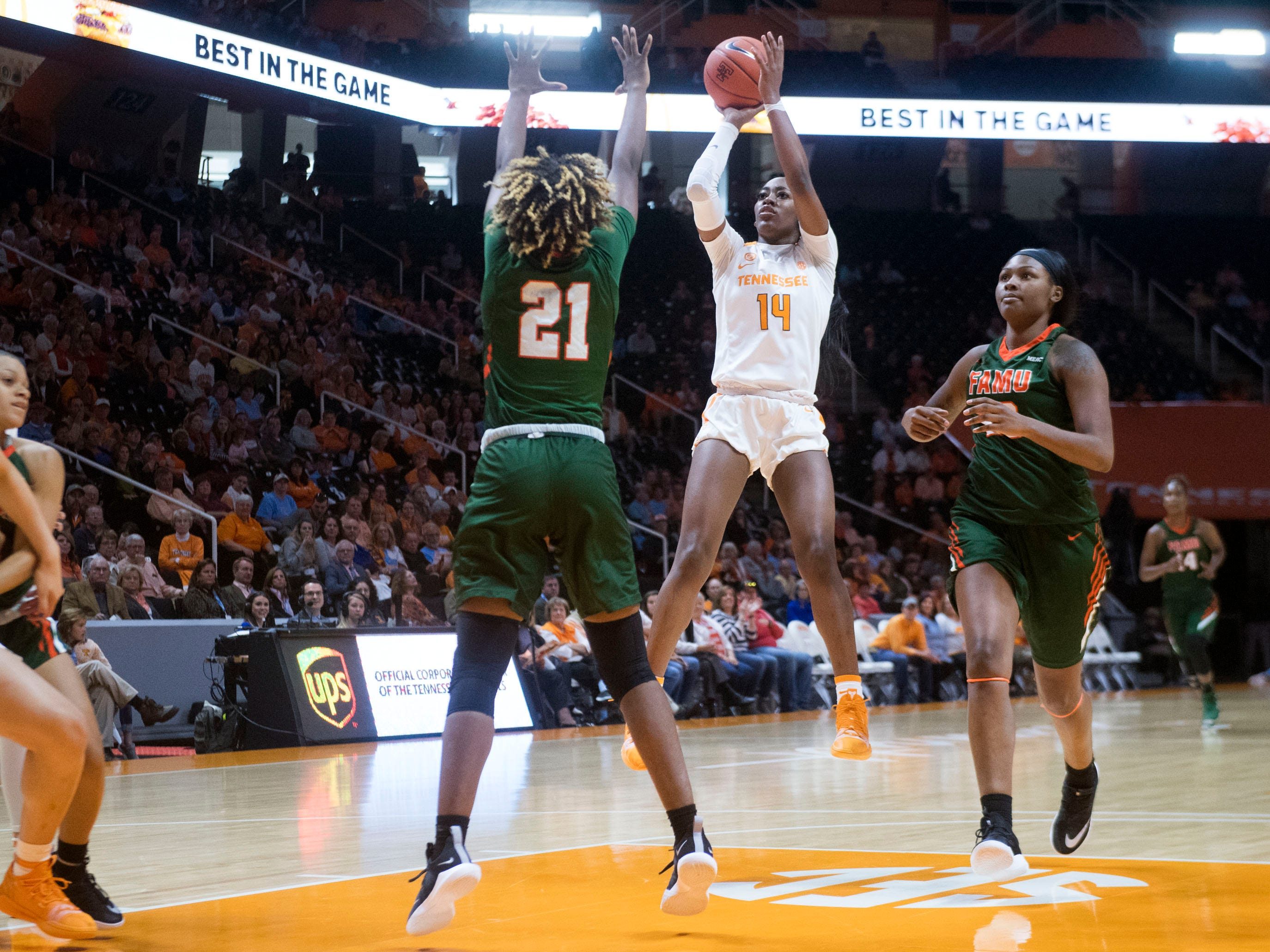 Tennessee's Zaay Green (14) gets a shot off while defended by Florida A&M's Keziah Dilworth (21) on Sunday, November 18, 2018 at Thompson-Boling Arena.