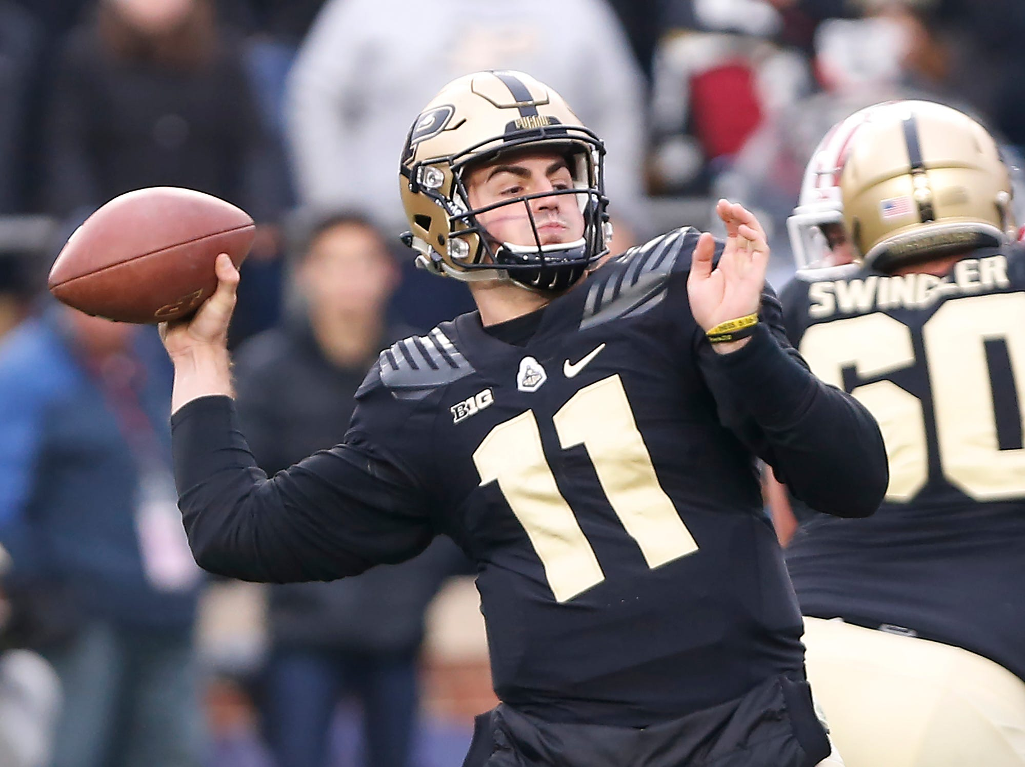 Purdue quarterback David Blough with a first half pass against Wisconsin Saturday, November 17, 2018, at Ross-Ade Stadium.
