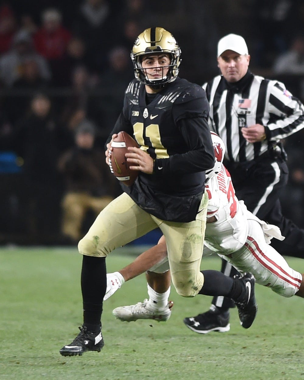 Scenes from senior day at Ross-Ade Stadiuim as the Boilers drop a heart breaker to Wisconsin in three OTs. David Blough