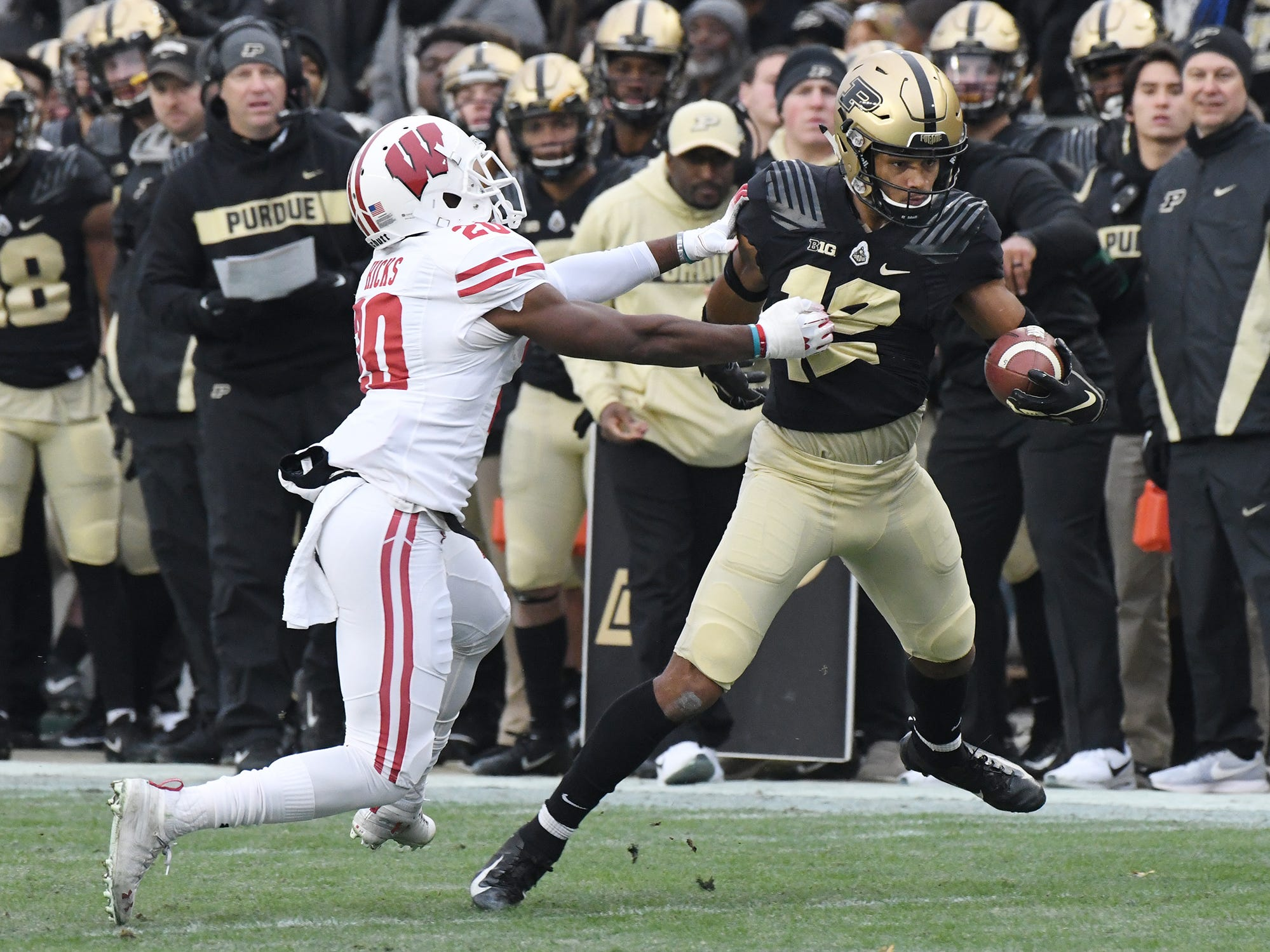 Jared Sparks of Purdue tries to shake free of Faion Hicks of Wisconsin after a fist half pass reception Saturday, November 17, 2018, at Ross-Ade Stadium.