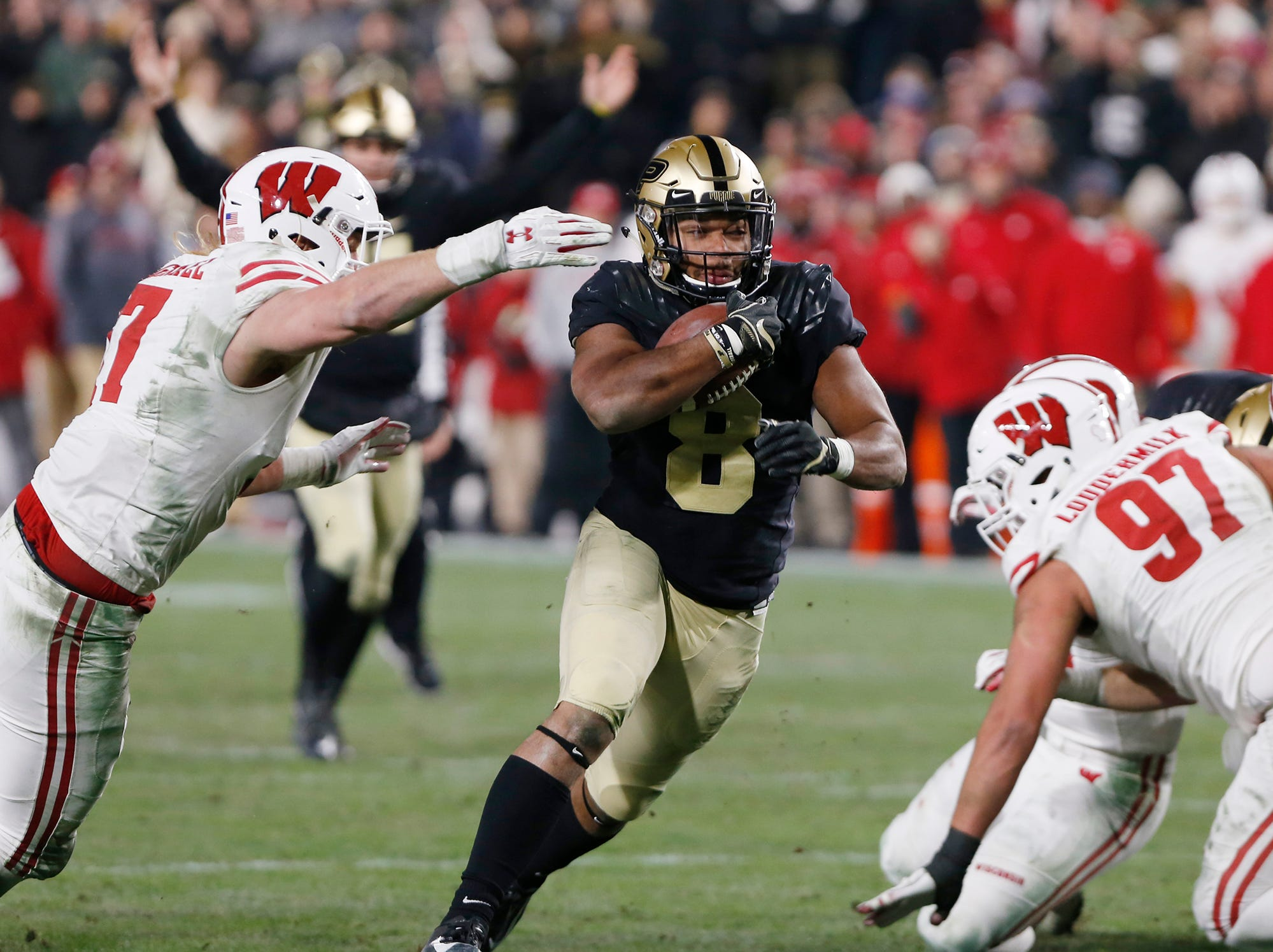 Markell Jones of Purdue finds a hole in the  Wisconsin defensive line and carries for a touchdown at 4:08 in the third quarter Saturday, November 17, 2018, at Ross-Ade Stadium. Purdue fell to Wisconsin 47-44 3OT.