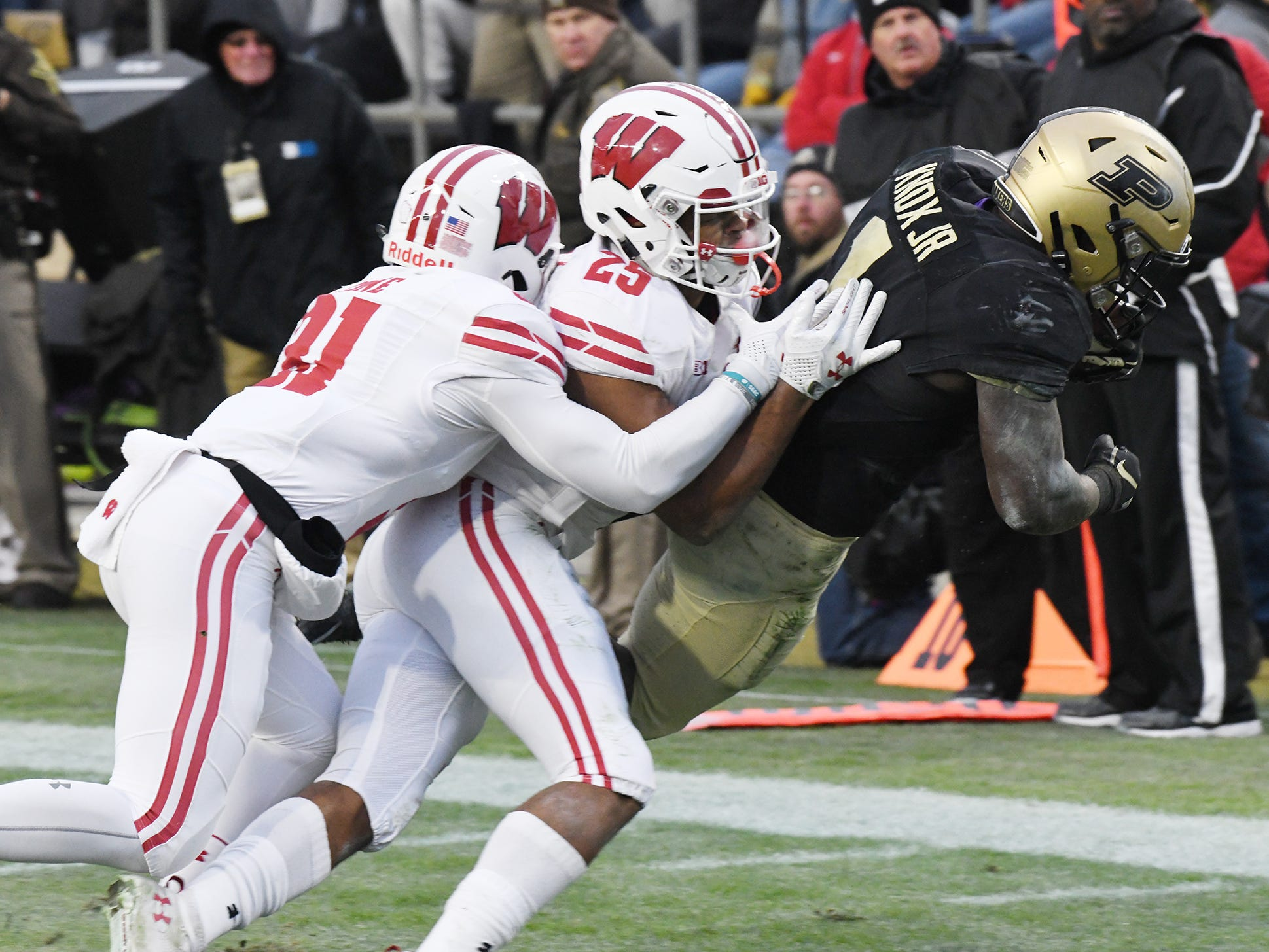 D. J. Knox drags two Wisconsin defenders as he dives across the goal line on a first half touchdown reception Saturday, November 17, 2018, at Ross-Ade Stadium.