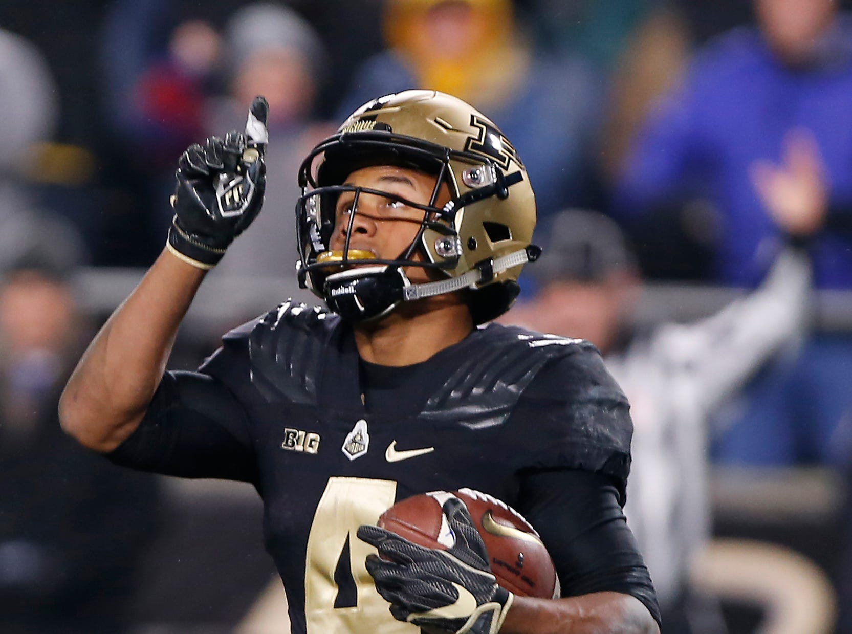Rondale Moore of Purdue points skyward after his touchdown reception with 57 seconds remaining in the third quarter against Wisconsin Saturday, November 17, 2018, at Ross-Ade Stadium. Purdue fell to Wisconsin 47-44 3OT.
