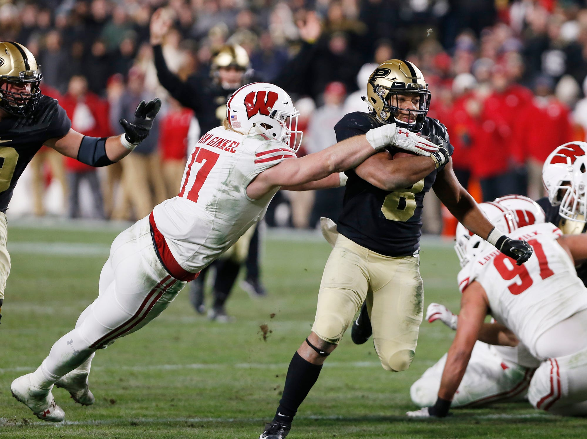Markell Jones of Purdue shakes off Andrew Van Ginkel of Wisconsin and runs for a touchdown at 4:08 in the third quarter Saturday, November 17, 2018, at Ross-Ade Stadium. Purdue fell to Wisconsin 47-44 3OT.