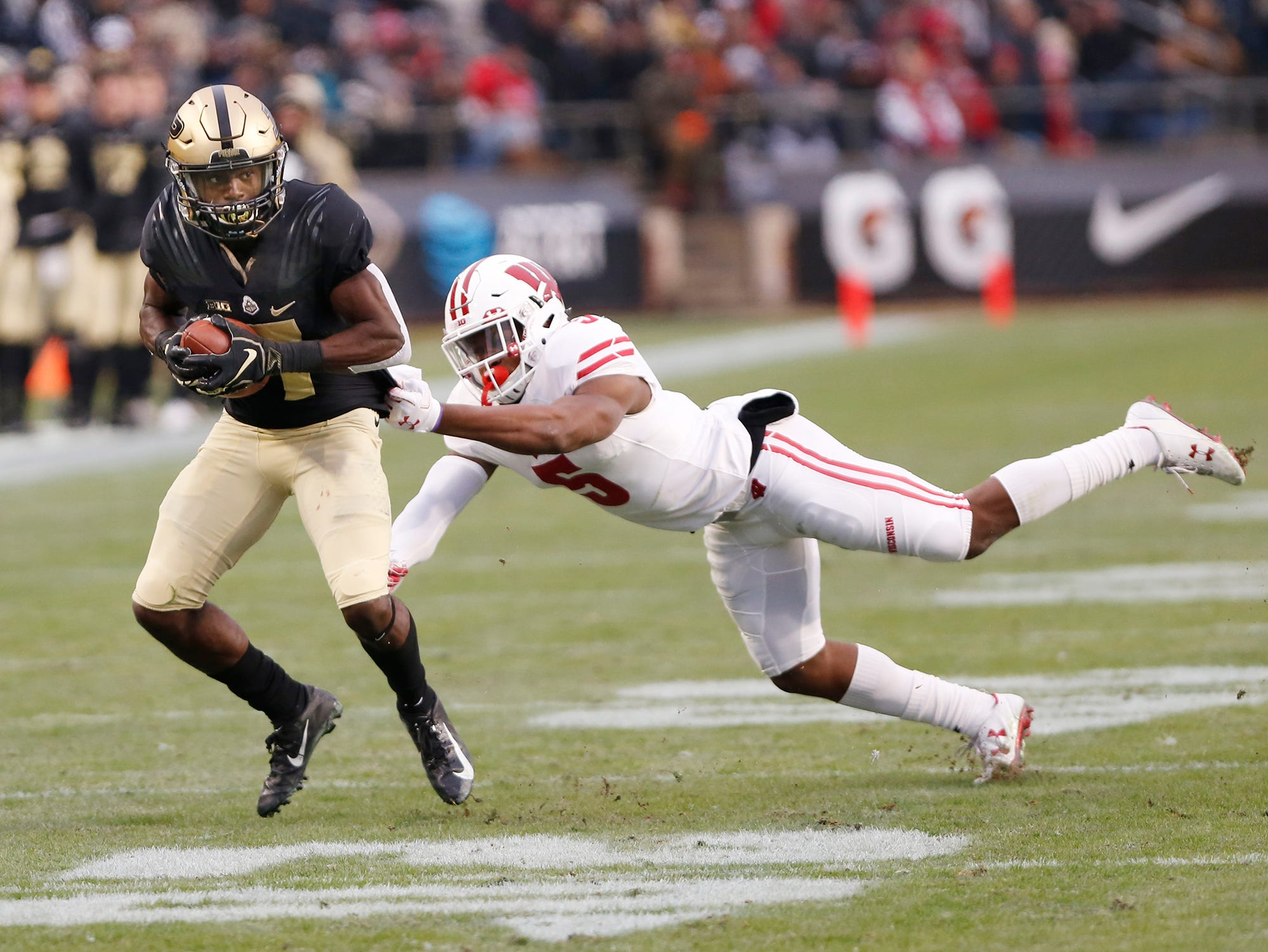 Isaac Zico of Purdue shakes free of Rachad Wildgoose of Wisconsin after a first half pass reception Saturday, November 17, 2018, at Ross-Ade Stadium.