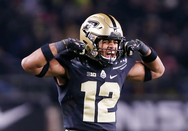 Jared Sparks of Purdue flexes his muscles after teammate Markell Jones rushed for a touchdown at 4:08 in the third quarter against Wisconsin Saturday, November 17, 2018, at Ross-Ade Stadium. Purdue fell to Wisconsin 47-44 3OT.