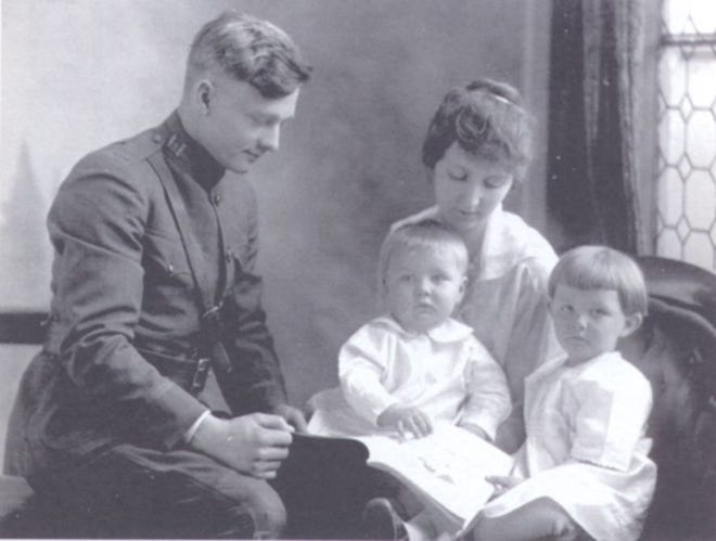Harry Spring is reunited with his family after he served World War I. With Harry are his wife, Elsie, and their first two children, Donald and Marjorie Jane. Donald was born while his father was training at Fort Leavenworth. Harry Spring