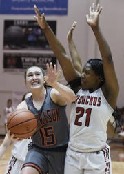 Harrison guard Anna Henderson fights her way past Jeff's Kiara Lewis in the Hoops Classic championship Saturday night.
