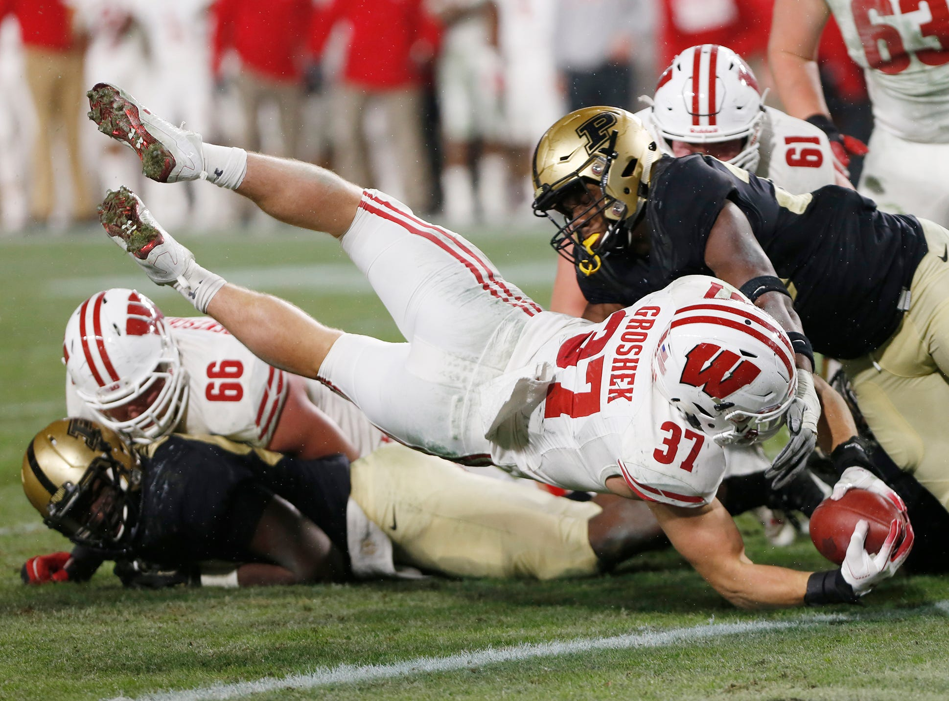 Garrett Groshek of Wisconsin dives into the end zone for a touchdown in the second overtime period against Purdue Saturday, November 17, 2018, at Ross-Ade Stadium. Purdue fell to Wisconsin 47-44 3OT.