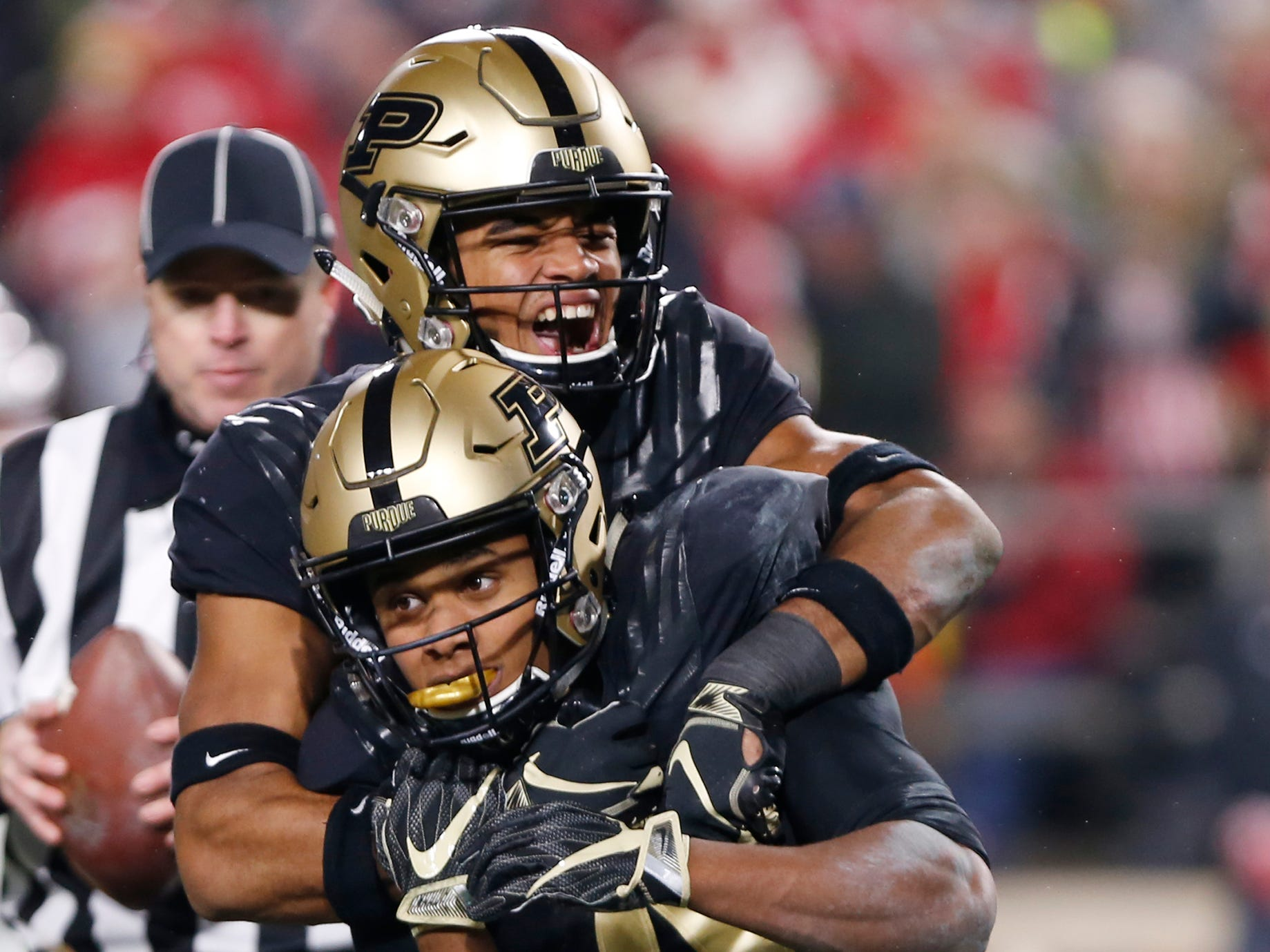 Rondale Moore, foreground, of Purdue celebrates with teammate Jared Sparks after his touchdown reception with 57 seconds remaining in the third quarter against Wisconsin Saturday, November 17, 2018, at Ross-Ade Stadium. Purdue fell to Wisconsin 47-44 3OT.