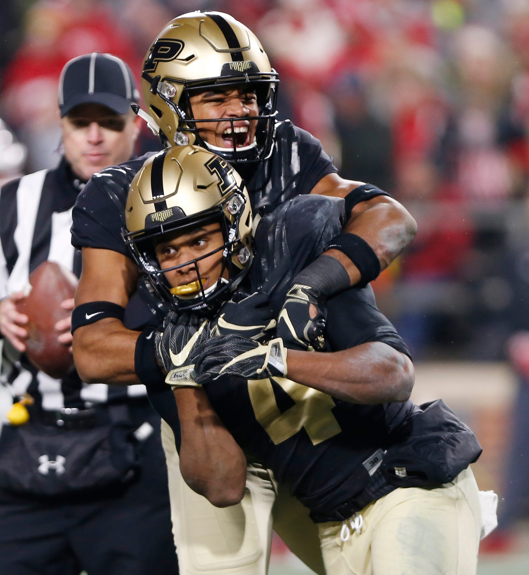 Rondale Moore, foreground, of Purdue celebrates with teammate Jared Sparks after his touchdown reception with 57 seconds remaining in the third quarter against Wisconsin.